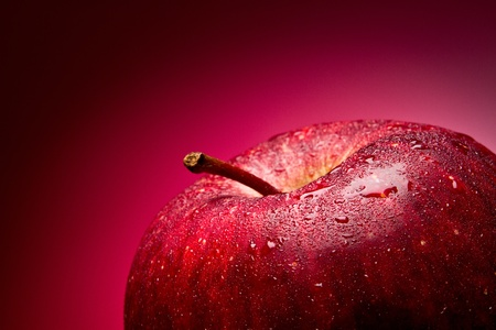 Red apple. Macro. on a red gradient