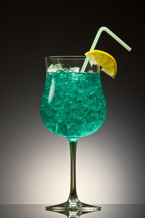 blue hawaiian drink: Blue Hawaiian cocktail on a gray gradient Stock Photo