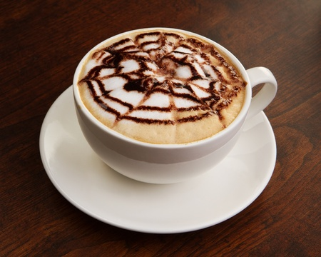 capuccino: Chocolate cappuccino time.Cup of coffee