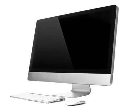 monitor de computadora: Ordenador de sobremesa con rat�n y teclado inal�mbrico Foto de archivo