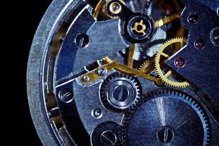 time machine: Clockwork macro isolated over the black background