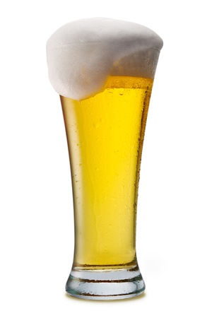 Beer into glass isolated on white photo
