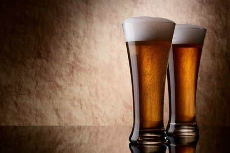 pouring beer: Beer into glass on a old stone