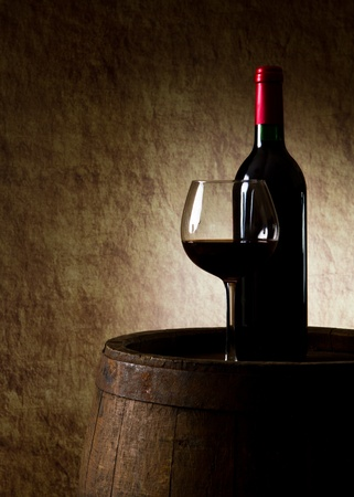 iron hoops: the still life with red wine, bottle, glass and old barrel