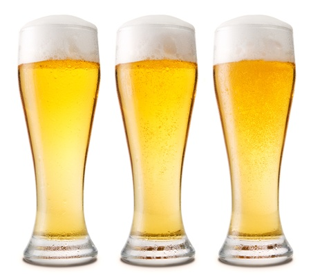 Beer into glass isolated on white. three options photo
