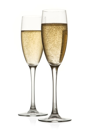 champagne flutes: Two glasses of champagne. Isolated on white backgroun