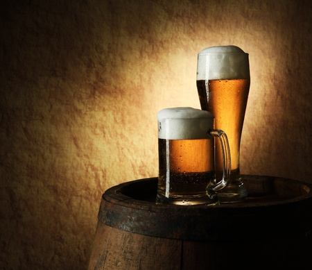 Still Life of beer and barrel on a old stone