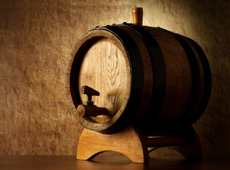wine grower: Barrel on a old stone