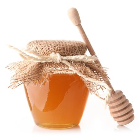 Honey with wood stick photo