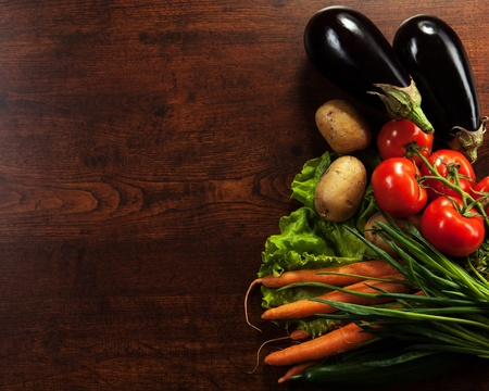 farmers' market: abstract design background vegetables on a wooden background Stock Photo