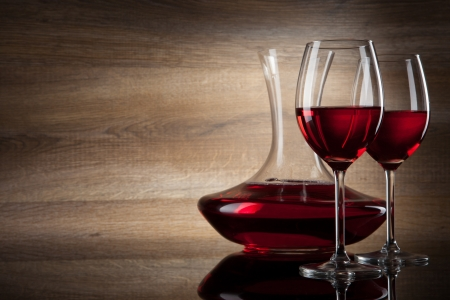glass of red wine: two Wine glass and decanter on a wooden Background