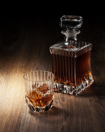 woden: glass and bottle with whiskey on a woden table Stock Photo