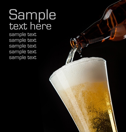 beer glass and bottle on a black