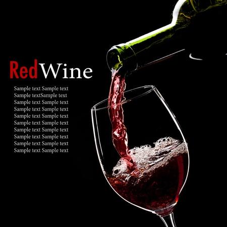 cabernet sauvignon: red wine poured into glass