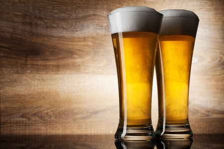 wino: Two glass beer on wood background with copyspace