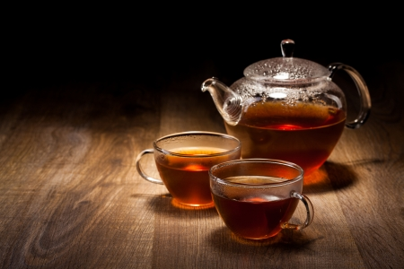 chinese teapot: Tea Set on a Wooden Table Stock Photo