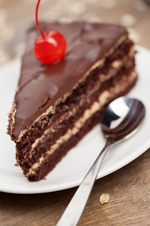 chocolate icing: slice of chocolate cake with cherry
