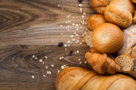 assortment of baked bread on wood table with copy space photo