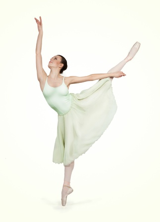 young beautiful ballerina on a gray background photo