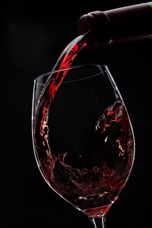 red wine poured into glass photo