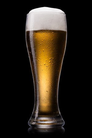 beer glass: Beer into glass on a black