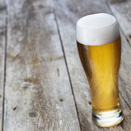 brewing: Glass beer on wood background with copyspace