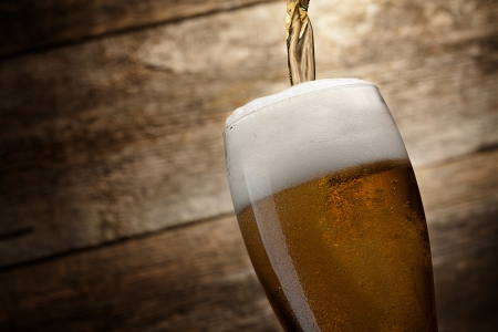 glass beer on wood background with copyspace Stock Photo