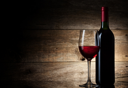 expensive food: Wine glass and Bottle on a wooden background