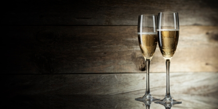 champagne flute: two glass with champagne on a wooden background Stock Photo