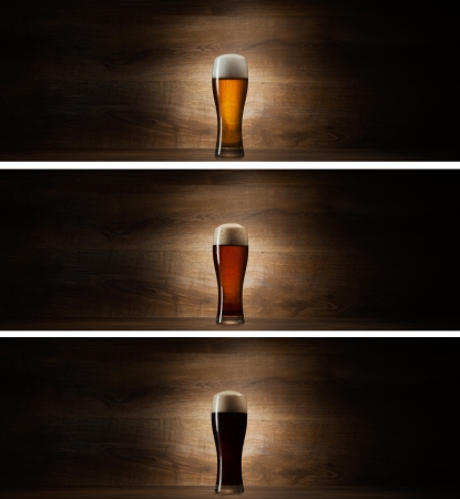 glass beer on wood background with copyspace photo