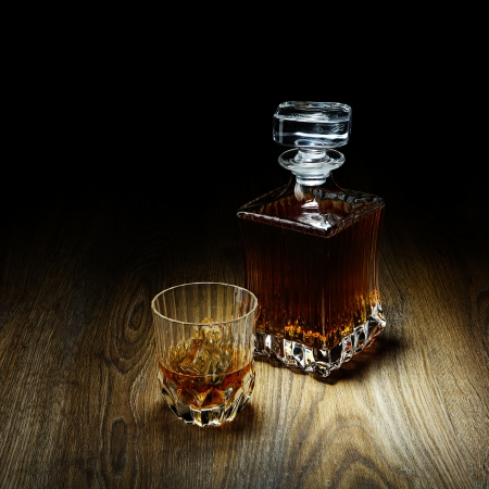 whiskey in glass and bottle photo