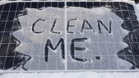 Clean me. Solar panel in the snow. Solar cells generate less energy during precipitation, shade, at night, in rain.close-up