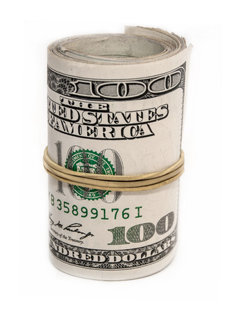 Hundred dollar rolled up on white background Stock Photo