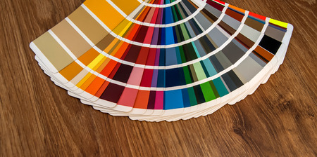 Colour swatches book on wooden background