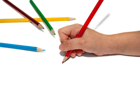hand pencil: Childrens hand with colored pencils