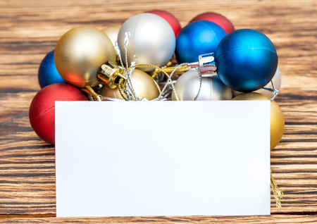 Christmas balls with blank business card on the table new year christmas balls with blank business card on the table new year background stock photo reheart Images