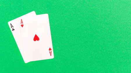 Two aces on a green background. Copy space. Top view.