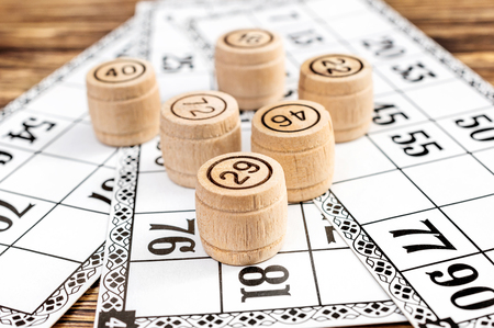 Wooden kegs of lotto on cards.