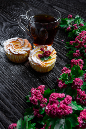 wenge: Black tea and muffins on a wooden background Stock Photo