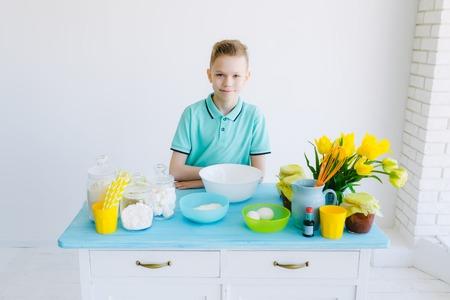 preparing dough: Boy preparing dough in the kitchen, breakfast