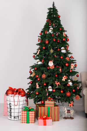 Christmas tree with gifts on a white background