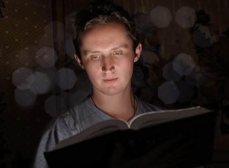 Man reading book in darkness Stock Photo - 6140111