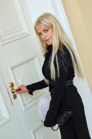 Woman open door photo