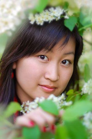 Portrait of beautiful asian girl in green leafs photo
