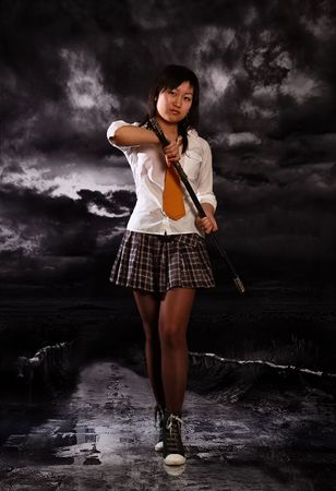 Beautiful japan schoolgirl with katana in her hands photo