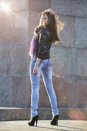 women in jeans: Beautiful asian woman posing outdoors