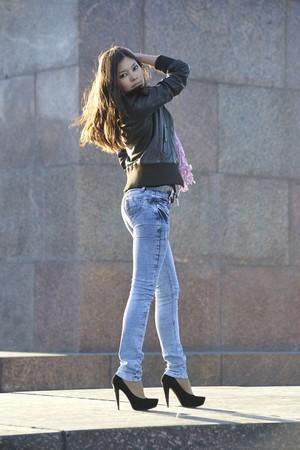 Beautiful asian woman posing outdoors photo