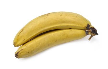 Old bananas isolated over white background photo