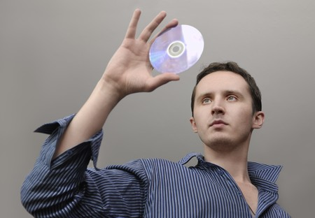 Man with compact disc in hand photo