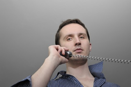 Young man talking by phone Stock Photo - 7041396
